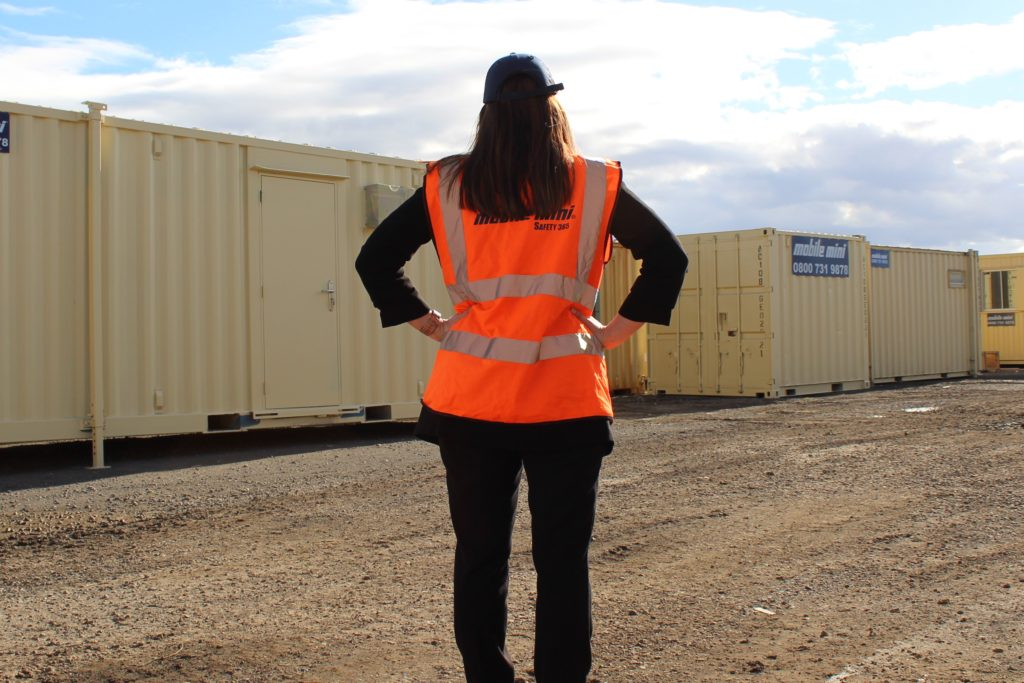 Woman working in construction, hi vis jacket