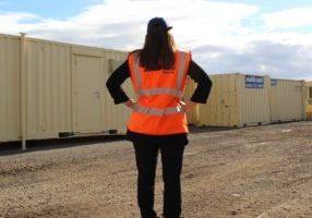 Woman working in construction, hi vis jacket